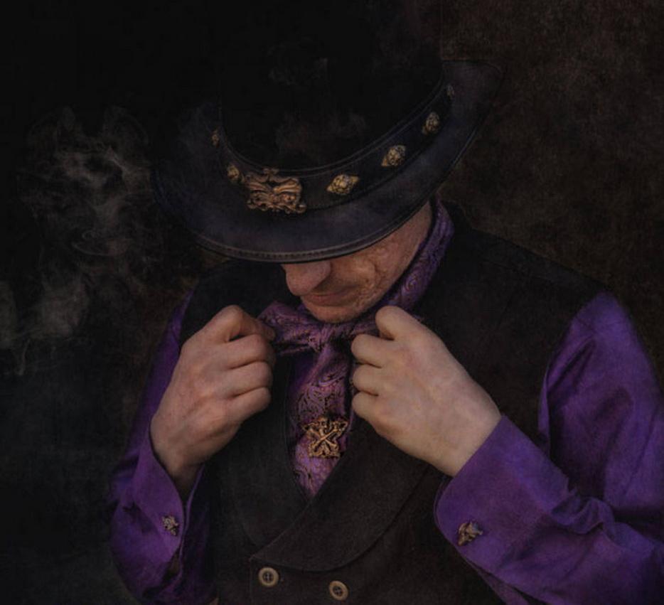 Jewelry: Skull & Crossbones Cravat Pin, Demon Skull cufflinks, bronze filigree Hatband Model: James Miller Photographer: Colleen Sternberger